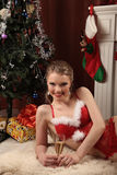 Woman celebrating christmas, smiling woman in evening dress with glass of sparkling champagne Royalty Free Stock Photos