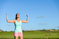 Woman celebrating fitness and running success Royalty Free Stock Photos