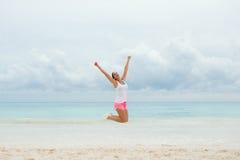 Woman celebrating fitness workout success Royalty Free Stock Photo