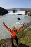 Woman Celebrating At Godafoss Waterfall, Iceland Royalty Free Stock Photography