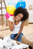 Woman celebrating her new home Stock Photos