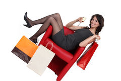 Woman celebrating her shopping Stock Images