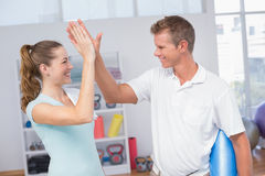 Woman celebrating with her trainer Royalty Free Stock Photography