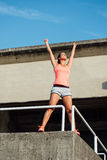 Woman celebrating sport and fitness success Royalty Free Stock Images