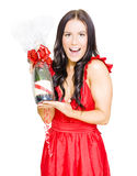 Woman Celebrating Success With Champagne Bottle Royalty Free Stock Images