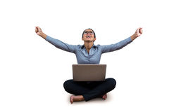 Woman celebrating while using her laptop. Against a white background Royalty Free Stock Image