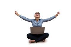 Woman celebrating while using her laptop Royalty Free Stock Image
