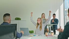 Woman Celebrating Victory Looking at Laptop. Business Woman celebrating success victory looking at the laptop diverse people group clapping expressing excitement stock footage