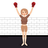 Woman celebrating win in boxing wearing gloves winner strong competition Royalty Free Stock Photography