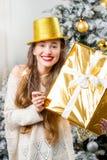 Woman celebrating winter holidays Stock Photos