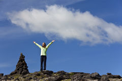 Woman CelebratingAt The Top Of A Mountain Stock Image