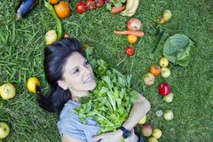 Woman with a celery Stock Photos