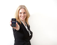 Woman with cell phone. Blonde woman is presenting a cellular telephone Stock Photo