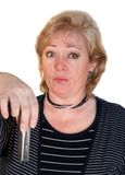 Woman cell phone. Woman considering dropping cell phone royalty free stock images
