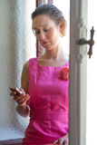 Woman and cell phone Stock Image