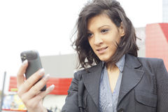 Woman with cell phone Stock Images