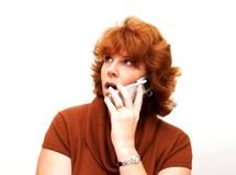Woman on Cell Phone. A woman talking on a cell phone with an isolated background Stock Photo