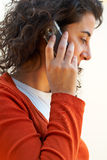 Woman on a cell phone. A young woman on a cell phone royalty free stock photo