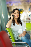 Woman cell phone airport Stock Photos