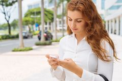 Woman with cell phone Royalty Free Stock Photos