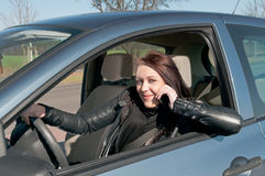 Woman with  cell phone in the car Royalty Free Stock Photo