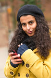 Woman with cell phone in fall nature Stock Photos