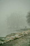 Woman with cell phone in fog Royalty Free Stock Photography
