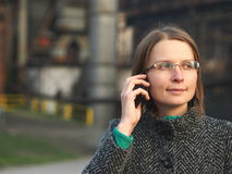 Woman with a cell phone Stock Photos