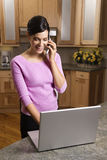 Woman on Cell Phone with Laptop Stock Photos