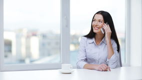 Woman with cell phone making a call Stock Photo