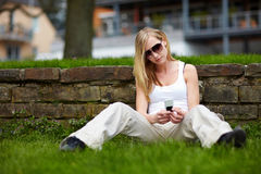 Woman with cell phone outdoors Royalty Free Stock Photo
