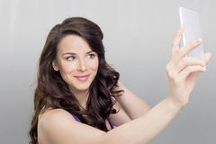 Woman with a cell phone Royalty Free Stock Photos