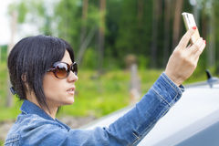Woman with cell telephone on the road Stock Photo
