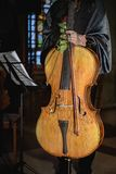 Woman cellist standing with a violoncello. After a concert royalty free stock image
