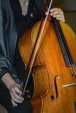 Woman cellist with a violoncello. Close view stock photography