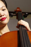 Woman and cello. Close up of woman play cello Royalty Free Stock Image