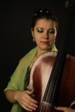 Woman with cello Stock Images