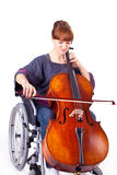 Woman with cello on wheelchair Royalty Free Stock Images