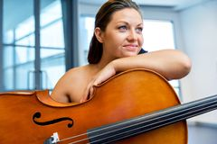 Woman with a cello. Young smiling woman with a cello royalty free stock photos