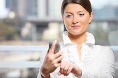 Woman with a cellphone Stock Photos