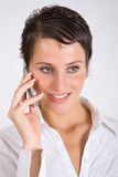 Woman with cellphone Stock Images