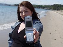 Woman with cellphone on beach Royalty Free Stock Photo