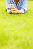 Woman with cellphone on grass Royalty Free Stock Photos