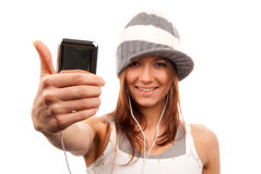 Woman with cellphone headphones thumb up Royalty Free Stock Photography
