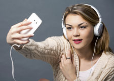 Woman and cellphone Stock Photography