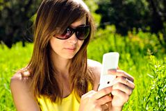 Woman with cellular Royalty Free Stock Photography