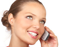 Woman with cellular. Attractive young woman calling by cellular phone. Isolated over white Royalty Free Stock Image