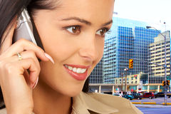 Woman with cellular. Attractive young woman calling by cellular phone Royalty Free Stock Images