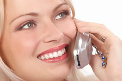 Woman with cellular. Attractive young woman calling by cellular phone. Isolated over white Stock Images