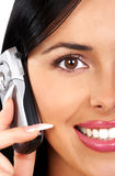 Woman and cellular phone. Smiling young woman calling by  cellular phone Stock Photos